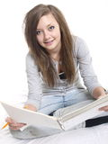 Teenage student. A teenage student writing and reading Stock Photography