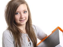 Teenage student. A teenage student writing and reading Royalty Free Stock Images