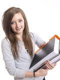 Teenage student. A teenage student writing and reading Royalty Free Stock Photo