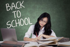 Teenage student back to school and studying in class Stock Image