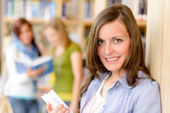 Teenage student with book at school library Royalty Free Stock Images