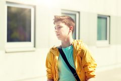 Teenage student boy walking outdoors. Education, high school and people concept - teenage student boy walking outdoors Stock Images