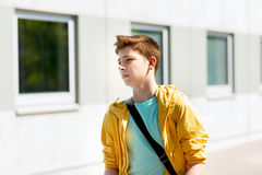 Teenage student boy walking outdoors. Education, high school and people concept - teenage student boy walking outdoors Stock Photography