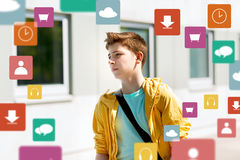 Teenage student boy walking outdoors. Education, high school and people concept - teenage student boy walking outdoors Royalty Free Stock Images