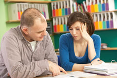 Teenage Student In Classroom Stock Photo