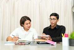 Teenage Student In Classroom With Tutor. Teenage Boy Studying With Home Tutor Stock Image