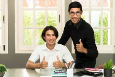 Teenage Student In Classroom With Tutor. Teenage Boy Studying With Home Tutor Royalty Free Stock Image