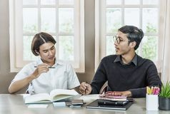 Teenage Student In Classroom With Tutor. Teenage Boy Studying With Home Tutor Royalty Free Stock Photos