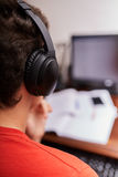 Teenage student doing homework Stock Photography