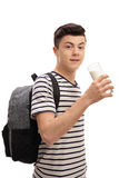 Teenage student drinking a glass of milk Royalty Free Stock Photos