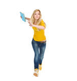 Teenage student girl with books running. Isolated on white Stock Image