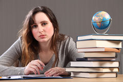 Teenage student girl doing geography homework Royalty Free Stock Photography