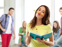 Teenage student girl with notebook and pencil stock photo