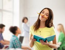 Teenage student girl with notebook at school stock photo