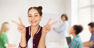 Teenage student girl showing peace at school Royalty Free Stock Photos