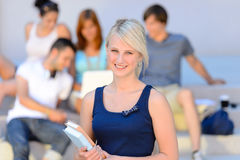 Teenage student girl smiling friends in background Royalty Free Stock Image