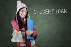 Teenage student giving money dollars Royalty Free Stock Photo