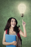 Teenage student with light bulb get an idea Royalty Free Stock Image