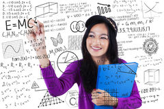 Teenage student makes math formula Royalty Free Stock Image