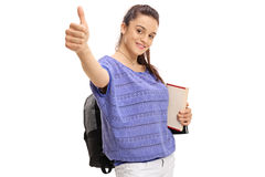 Teenage student making a thumb up gesture Royalty Free Stock Images