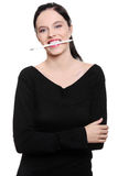Teenage student with pencil in her mouth. royalty free stock images