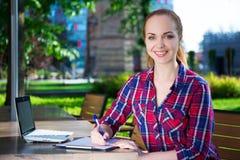 Teenage student or school girl doing her homework in park Stock Photography