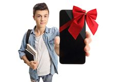 Teenage student showing a phone wrapped with red ribbon as a gif Stock Photos