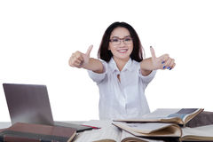 Teenage student showing thumbs up Stock Photo