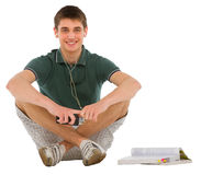 Teenage student sitting Royalty Free Stock Images