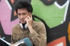 Teenage student talking on mobile telephone Stock Photos