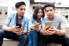 Teenage student using digital mobile phone stock photo
