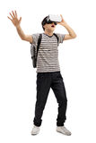 Teenage student with a VR headset. Full length portrait of a teenage student with a VR headset isolated on white background Stock Photo