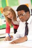 Teenage Student Working In Classroom Stock Photos