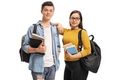 Teenage students with backpacks and books. Isolated on white background Stock Images