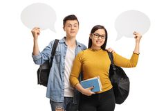Teenage students with chat bubbles. Isolated on white background Stock Image