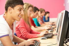 Teenage Students In IT Class Using Computers Stock Photos