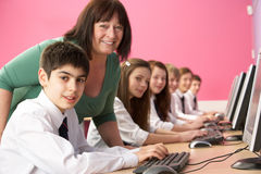 Teenage Students In IT Class Using Computers Stock Photography