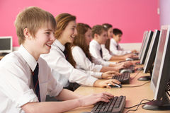 Teenage Students In IT Class Using Computers Stock Images