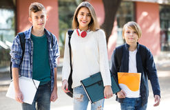 Teenage students going to college Stock Photos