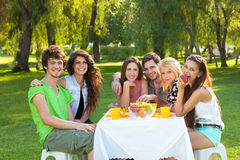 Teenage students having a relaxing meal outdoors Stock Photography