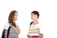 Teenage students looking one to each other. Teenage student girl looking to a teenage student boy holding his books Stock Photos