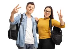 Teenage students making peace gestures. Isolated on white background Stock Images