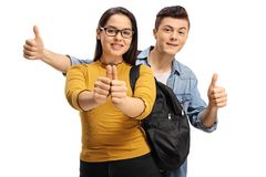 Teenage students making thumb up gestures. Isolated on white background Stock Photography