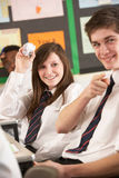 Teenage Students Misbehaving In Classroom. Throwing Paper Royalty Free Stock Photos