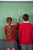Teenage Students Solving Mathematics On Board Royalty Free Stock Photos