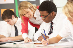 Teenage Students Studying In Classroom. With Teacher Royalty Free Stock Photo
