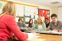 Teenage Students Studying In Classroom. With Teacher Royalty Free Stock Photos