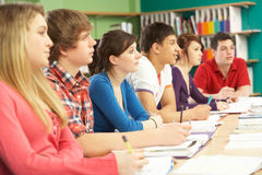 Teenage Students Studying In Classroom. Facing front Royalty Free Stock Photography