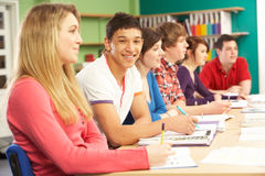 Teenage Students Studying In Classroom Royalty Free Stock Images