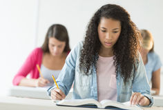 Teenage Students Studying At Desk Royalty Free Stock Photography
